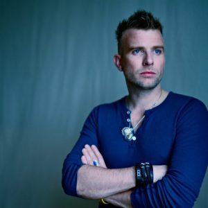 danish man wearing blue shirt